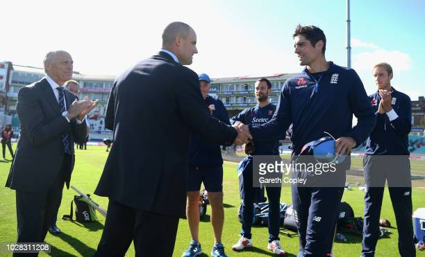 Andrew Strauss presents Alastair Cook of England with a commemorative hat during Day One of the Specsavers 5th Test match between England and India...
