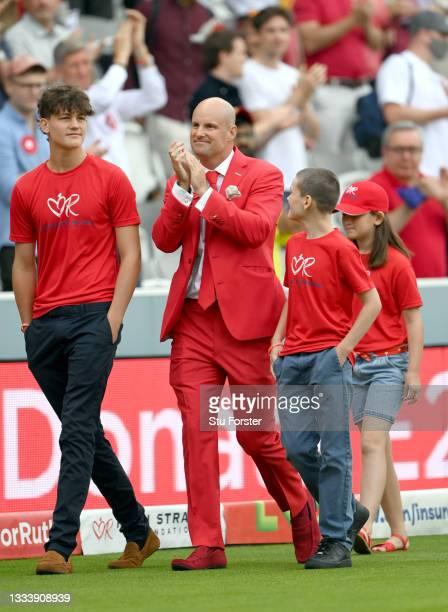 Andrew Strauss walks around the outfield with his two sons on Ruth Strauss Foundation Day during day two of the Second Test Match between England and...