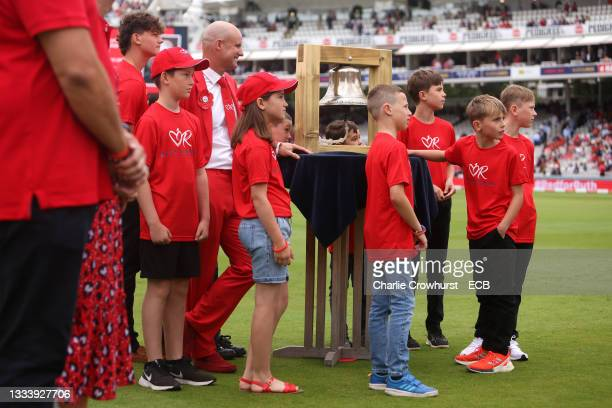 Andrew Strauss with Ruth Strauss Foundation families on #RedforRuth day during the Second LV= Insurance Test Match between England and India...