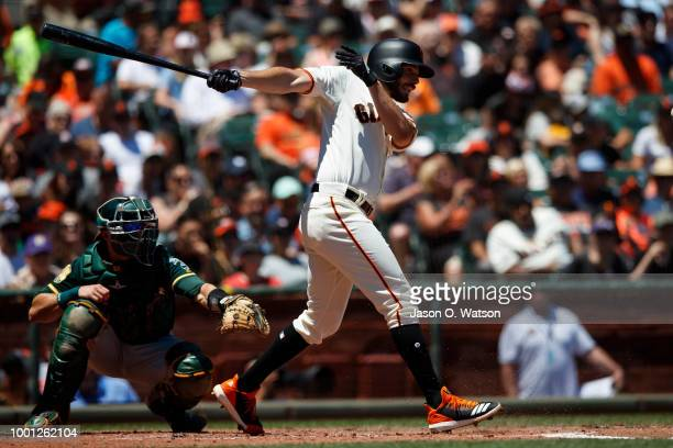Andrew Suarez of the San Francisco Giants at bat against the Oakland Athletics during the third inning at ATT Park on July 15 2018 in San Francisco...