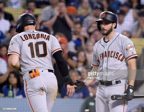 Andrew Suarez of the San Francisco Giants celebrates the run of Evan Longoria to take a 10 lead over the Los Angeles Dodgers during the second inning...