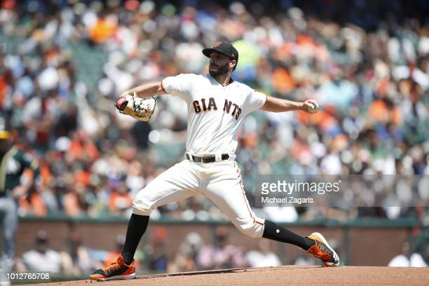 Andrew Suarez of the San Francisco Giants pitches during the game against the Oakland Athletics at ATT Park on July 15 2018 in San Francisco...