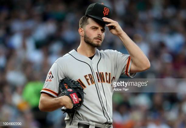 Andrew Suarez of the San Francisco Giants reacts after loading the bases with zero outs in the fourth inning against the Seattle Mariners during...