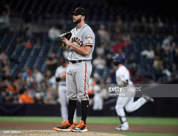 Andrew Suarez of the San Francisco Giants stands on the mound after giving up a solo home run to Austin Hedges of the San Diego Padres during the...