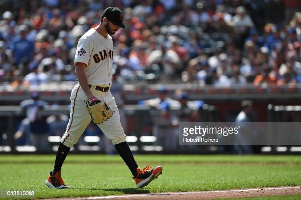 Andrew Suarez of the San Francisco Giants walks off after being pulled in the third inning during their MLB game against the Los Angeles Dodgers at...