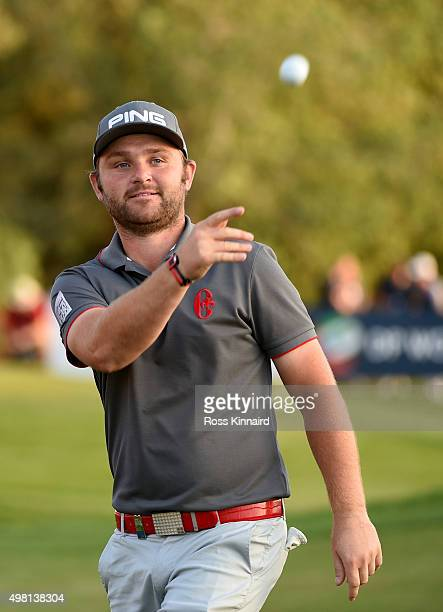 Andrew Sullivan of England acknowledges the crowd on the 18th green after making a par during the third round of the DP World Tour Championship on...
