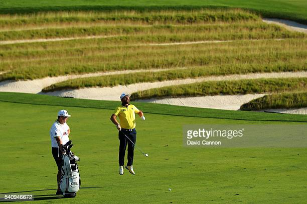 Andrew Sullivan of England jumps after playing his second shot on the third hole during the second round of the US Open at Oakmont Country Club on...