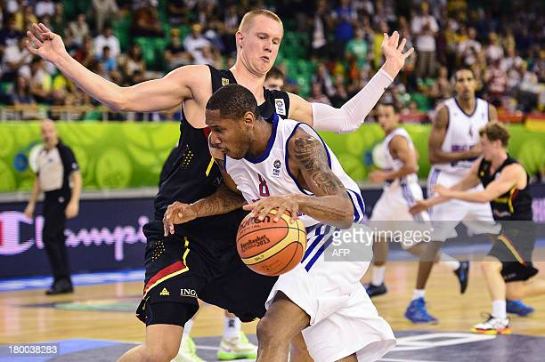 Andrew Sullivan of Great Britain vies for the ball with Robin Benzing of Germany during the European Basketball Championships match between Great...
