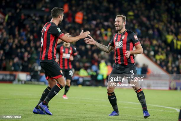 Andrew Surman congratulates Steve Cook of Bournemouth after he scores a goal to make it 21 during the Carabao Cup Fourth Round match between AFC...