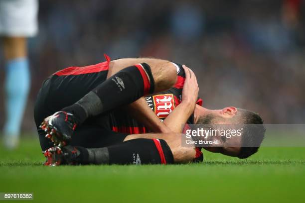 Andrew Surman of AFC Bornemouth goes down holding his shoulder during the Premier League match between Manchester City and AFC Bournemouth at Etihad...