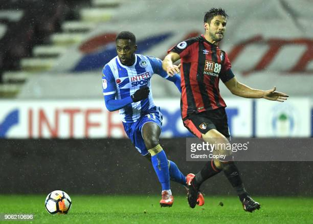 Andrew Surman of AFC Bournemouth and Gavin Massey of Wigan Athletic in action during The Emirates FA Cup Third Round Replay between Wigan and AFC...