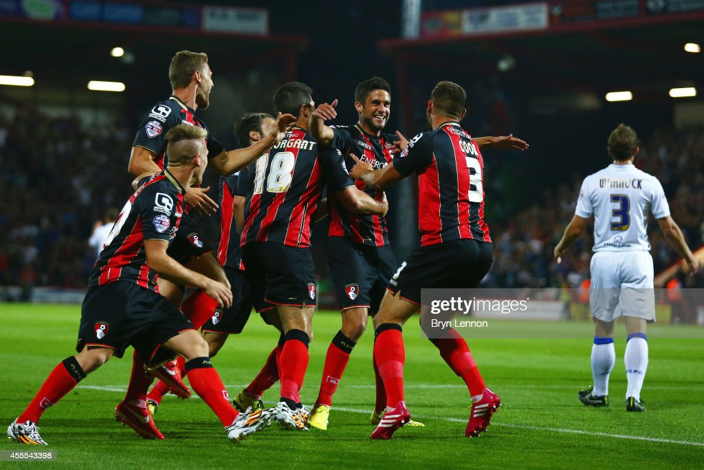 Andrew Surman (c) of AFC Bournemouth celebrates with his team scoring the opening goal during the Sky Bet Championship match between AFC Bournemouth and Leeds United at Goldsands Stadium on September 16, 2014 in Bournemouth, England.
