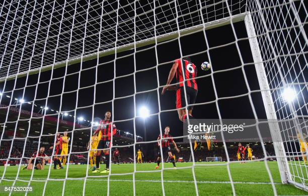 Andrew Surman of AFC Bournemouth clears a header by Shane Duffy of Brighton and Hove Albion off the line during the Premier League match between AFC...