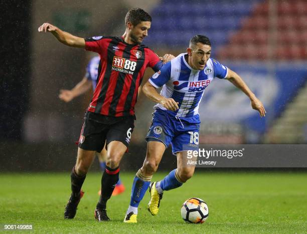Andrew Surman of AFC Bournemouth closes down Gary Roberts of Wigan Athletic during The Emirates FA Cup Third Round Replay between Wigan and AFC...