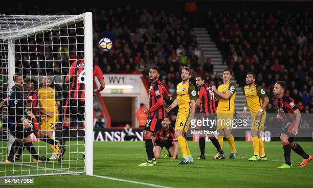 Andrew Surman of AFC Bournemouth heads a header by Shane Duffy of Brighton and Hove Albion off the line during the Premier League match between AFC...