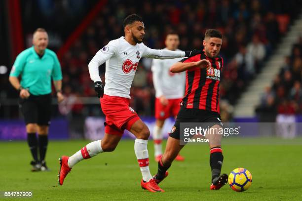 Andrew Surman of AFC Bournemouth is challenged by Sofiane Boufal of Southampton during the Premier League match between AFC Bournemouth and...
