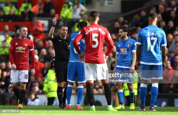 Andrew Surman of AFC Bournemouth is shown a red card by referee Kevin Friend during the Premier League match between Manchester United and AFC...