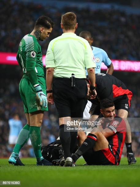 Andrew Surman of AFC Bournemouth receives treatment from the medical team during the Premier League match between Manchester City and AFC Bournemouth...