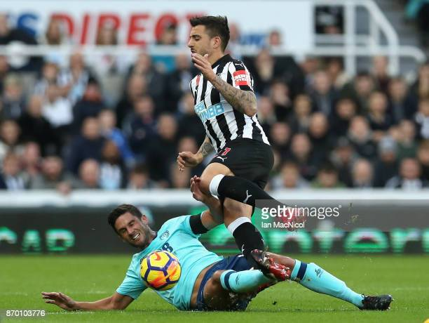 Andrew Surman of AFC Bournemouth tackles Joselu of Newcastle United during the Premier League match between Newcastle United and AFC Bournemouth at...