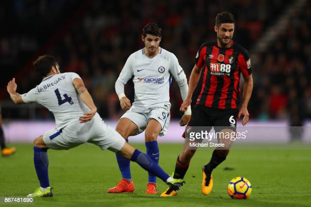 Andrew Surman of AFC Bournemouth takes the ball past Cesc Fabregas of Chelsea during the Premier League match between AFC Bournemouth and Chelsea at...