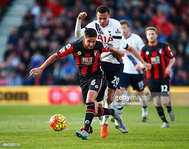 Andrew Surman of Bournemouth and Dele Alli of Tottenham Hotspur compete for the ball during the Barclays Premier League match between AFC Bournemouth...