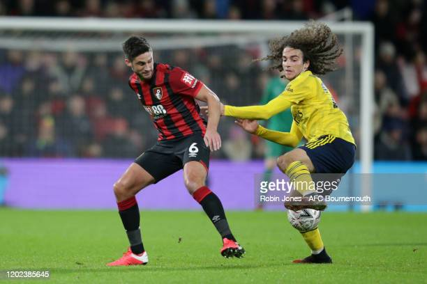 Andrew Surman of Bournemouth competes for the ball with Matteo Guendouzi of Arsenal during the FA Cup Fourth Round match between Bournemouth and...