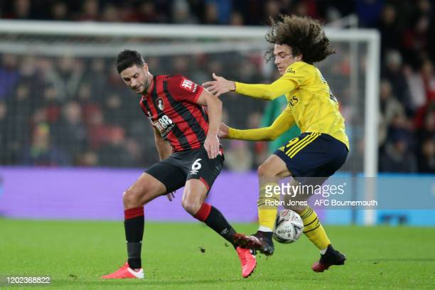Andrew Surman of Bournemouth of Bournemouth and Matteo Guendouzi of Arsenal during the FA Cup Fourth Round match between Bournemouth and Arsenal at...