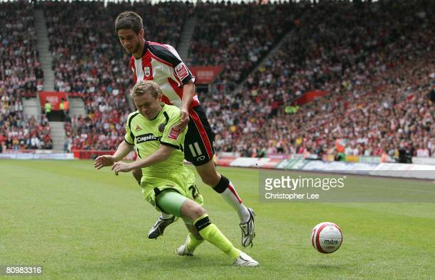 Andrew Surman of Southampton battles with Derek Geary of Sheffield during the CocaCola Championship match between Southampton and Sheffield United at...