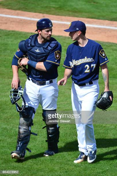 Andrew Susac and Zach Davies of the Milwaukee Brewers talk after closing out an inning against the Texas Rangers at Maryvale Baseball Park on March 4...