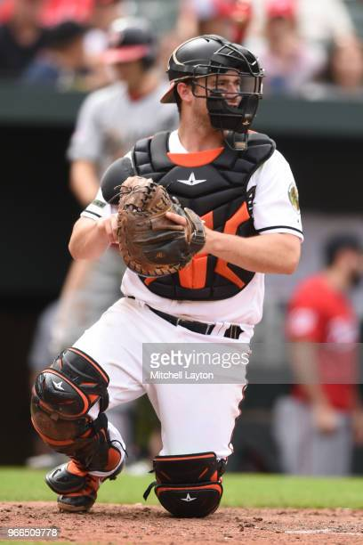 Andrew Susac of the Baltimore Orioles looks to throw to second base during a baseball game against the Washington Nationals at Oriole Park at Camden...