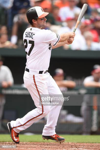 Andrew Susac of the Baltimore Orioles takes a swing during a baseball game against the Washington Nationals at Oriole Park at Camden Yards on May 28...