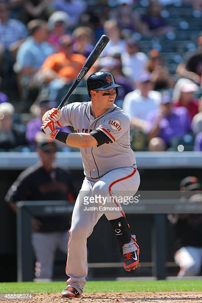 Andrew Susac of the San Francisco Giants bats against the Colorado Rockies at Coors Field on September 1 2014 in Denver Colorado The teams are...