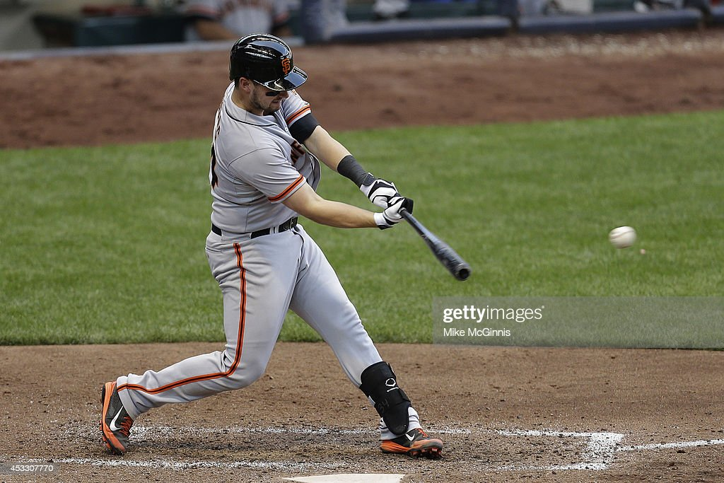 Andrew Susac #34 of the San Francisco Giants hits a single in the top of the seventh inning against the Milwaukee Brewers at Miller Park on August 07, 2014 in Milwaukee, Wisconsin.