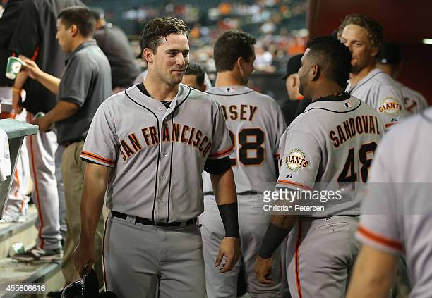 Andrew Susac of the San Francisco Giants reacts in the dugout after scoring a second inning run against the Arizona Diamondbacks during the MLB game...