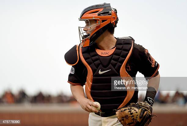 Andrew Susac of the San Francisco Giants runs off the field after the third out against the Atlanta Braves in the top of the first inning at ATT Park...