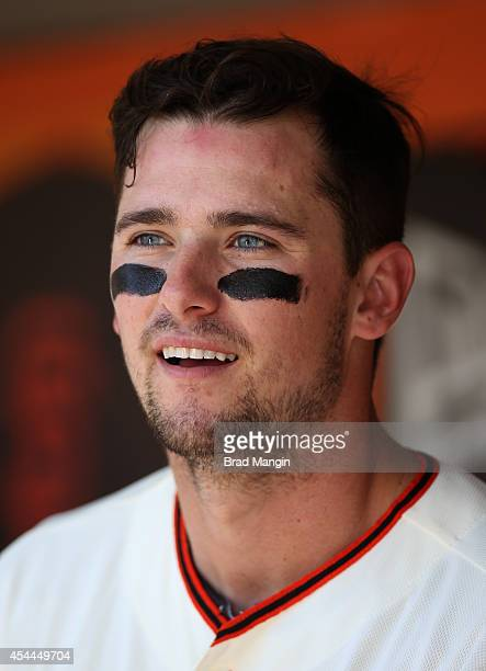 Andrew Susac of the San Francisco Giants sits in the dugout during the game against the Milwaukee Brewers at ATT Park on Sunday August 31 2014 in San...