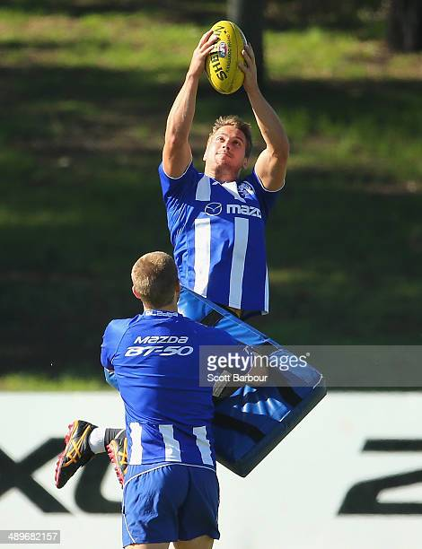 Andrew Swallow marks the ball during a North Melbourne Kangaroos AFL training session at Arden Street Ground on May 12 2014 in Melbourne Australia