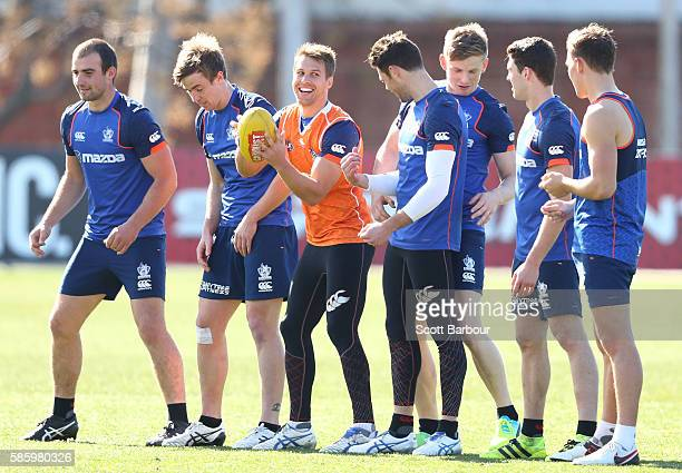 Andrew Swallow of the Kangaroos catches the ball surrounded by his teammates during a North Melbourne Kangaroos AFL training session at Arden Street...