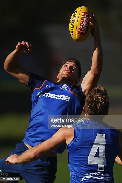 Andrew Swallow of the Kangaroos gathers the ball during a North Melbourne Kangaroos AFL media session at Arden Street Ground on May 5 2016 in...