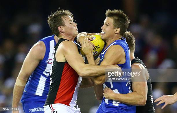 Andrew Swallow of the Kangaroos is tackled during the round 19 AFL match between the North Melbourne Kangaroos and the St Kilda Saints at Etihad...