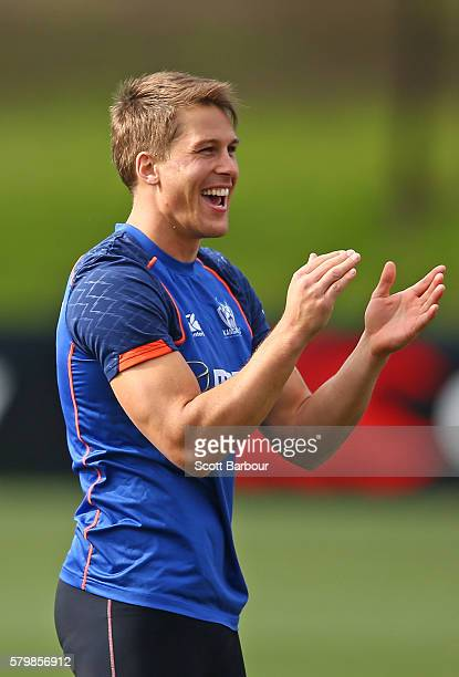 Andrew Swallow of the Kangaroos laughs during a North Melbourne Kangaroos AFL training session at Arden Street Ground on July 25 2016 in Melbourne...