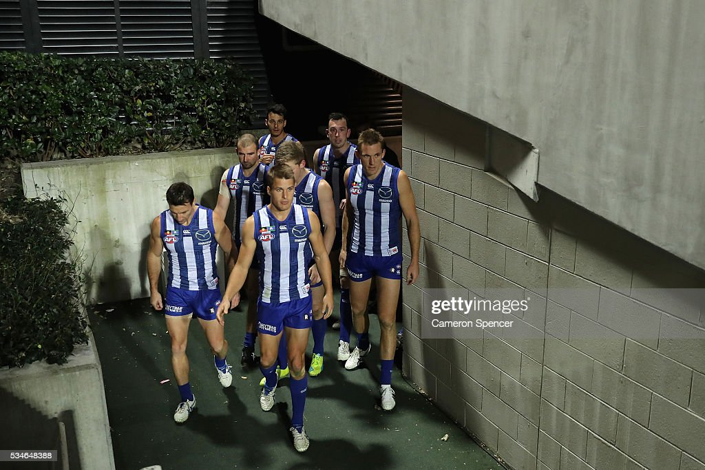 Andrew Swallow of the Kangaroos leads team mates onto the field during the round 10 AFL match between the Sydney Swans and the North Melbourne Kangaroos at Sydney Cricket Ground on May 27, 2016 in Sydney, Australia.