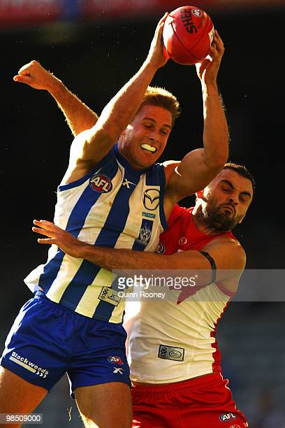 Andrew Swallow of the Kangaroos marks infront of Rhyce Shaw of the Swans during the round four AFL match between the North Melbourne Kangaroos and...