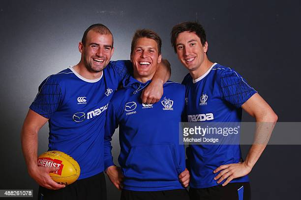 Andrew Swallow poses with Ben Cunnington and Sam Wright during a North Melbourne Kangaroos AFL media session at Arden Street Ground on September 15...