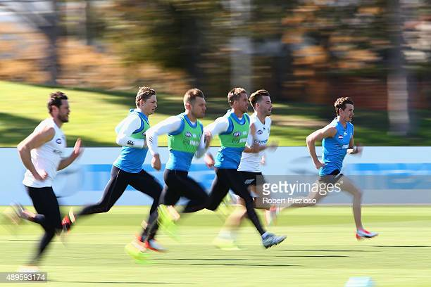 Andrew Swallow runs with teammates during a North Melbourne Kangaroos AFL training session at Arden Street Ground on September 23 2015 in Melbourne...