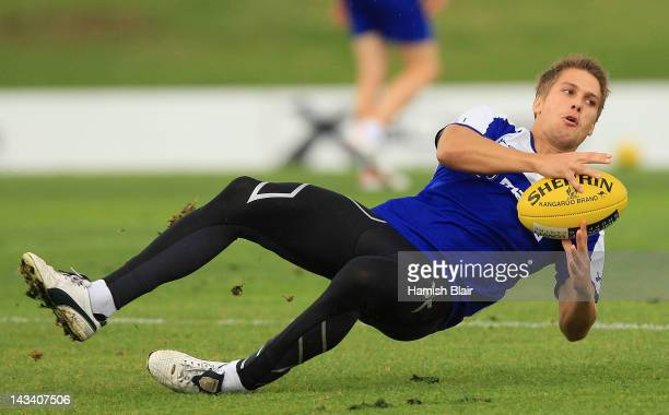 Andrew Swallow slips over during a North Melbourne Kangaroos AFL training session at Aegis Park on April 26 2012 in Melbourne Australia