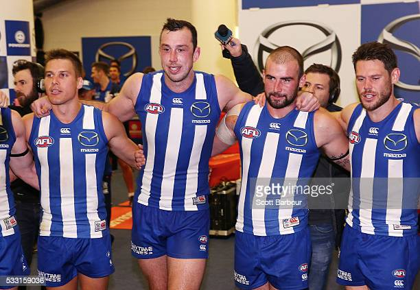 Andrew Swallow Todd Goldstein and Ben Cunnington of the Kangaroos sing the song in the rooms after winning the round nine AFL match between the North...