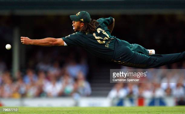 Andrew Symonds of Australia dives for a catch in the outfield during the Commonwealth Bank Series One Day International match between Australia and...
