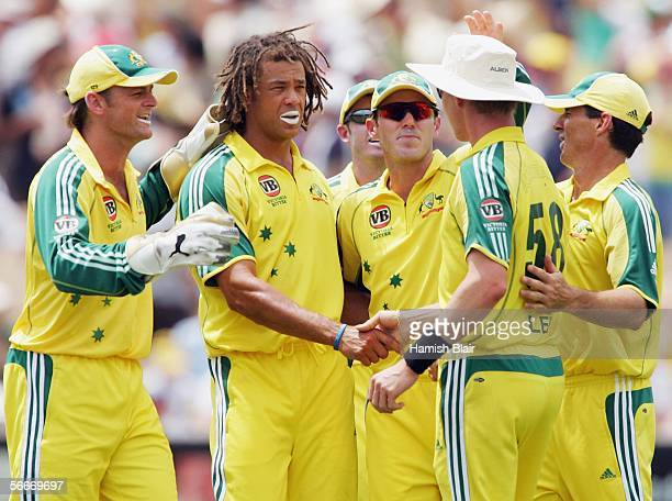 Andrew Symonds of Australia is congratulated by team mates on the wicket of Jehan Mubarak of Sri Lanka during game seven of the VB Series between...
