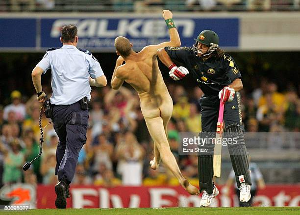 Andrew Symonds of Australia knocks over a streaker who ran onto the field during the Commonwealth Bank Series One Day International second final...